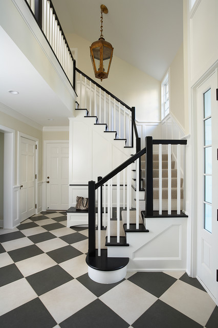 traditional entry with black and white stairs
