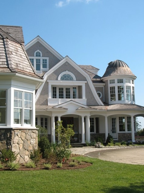 Classic Hamptons exterior - Timber shingled roof, white trim and Gambrel style roof.