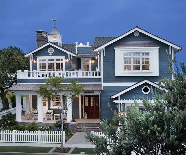 Classic nautical - Bold blue and white exterior with copper piping.